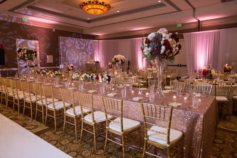 9 Waterfront Beach Resort Indian wedding venue Grand Ballroom reception Hindu banquet seating kings tables rectangular 54 - wedding venues in huntington beach